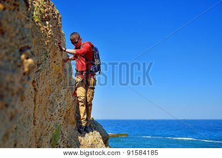 Tourist Walking On The Cliff