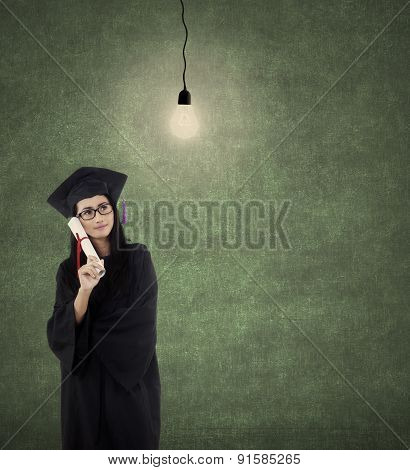 Graduate Student With Lightbulb
