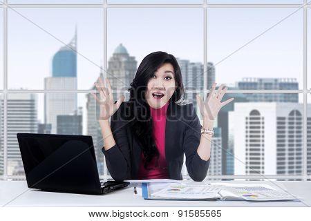 Happy Businesswoman Looks Shocked
