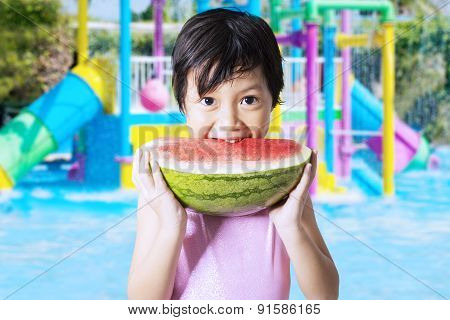 Kid Eats Watermelon At Pool