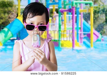 Little Girl Bite Ice Cream At Pool