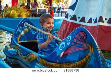 Portrait of a child at an amusement park.