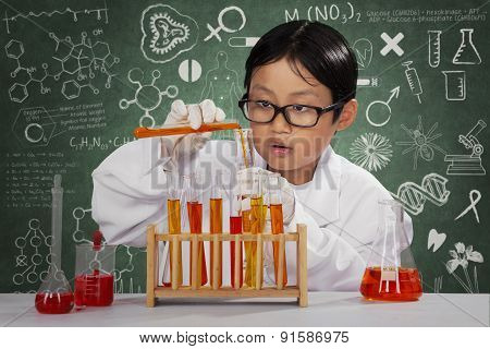 Schoolboy Playing Chemical In Laboratory