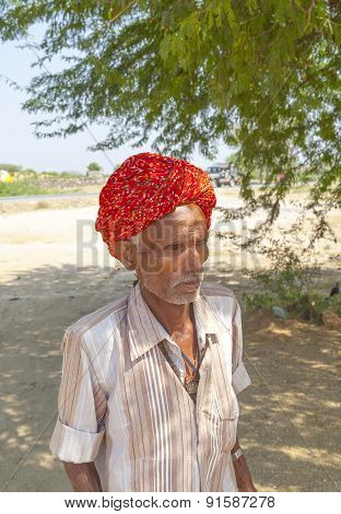 A Rajasthani Tribal Man Wearing Traditional Colorful Turban