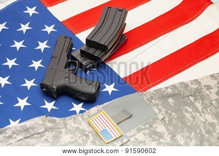 Handgun And Us Army Uniform Over Usa Flag
