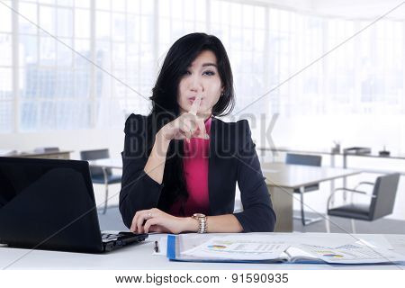 Young Manager Showing Silent Sign