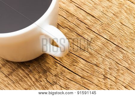 Close Up Shot Of Cup Of Black Coffee On Old Wooden Table