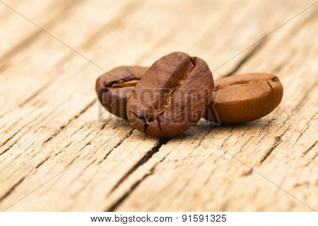 Coffee Beans On Wooden Table - Close Up Shot