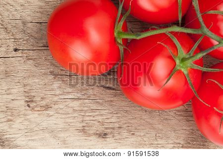 Bunch Of Red Tomatoes On Rustic Wooden Table - Close Up Studio Shot