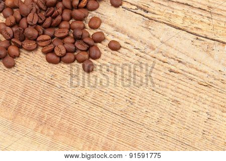 Coffee Beans Over Old Wooden Table - Close Up Shot
