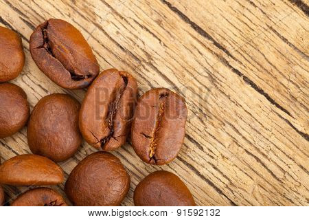Coffee Beans On Wooden Table - Close Up Studo Shot