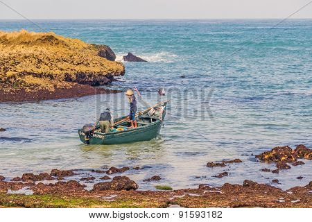 OUALIDIA, MOROCCO, APRIL 6, 2015: Fishermen  go to sea in fishing boat