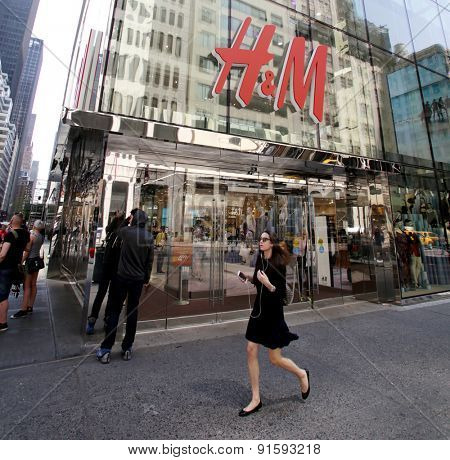 NEW YORK CITY - FRIDAY, MAY 8, 2015: Pedestrians walk past a H&M clothing retail store in Manhattan. H & M Hennes & Mauritz AB (H&M) is a Swedish multinational retail-clothing company.