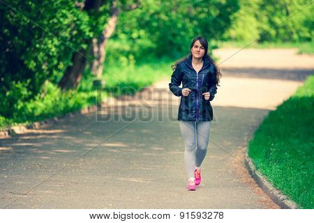 a young girl hurries in a park