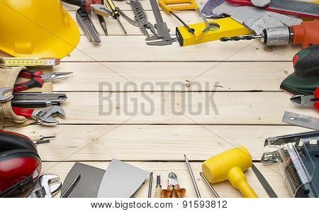 Construction equipments on natural wood background with copy space.