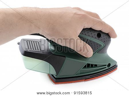Left handed carpenter's hand sanding with electrical sander isolated on white background.