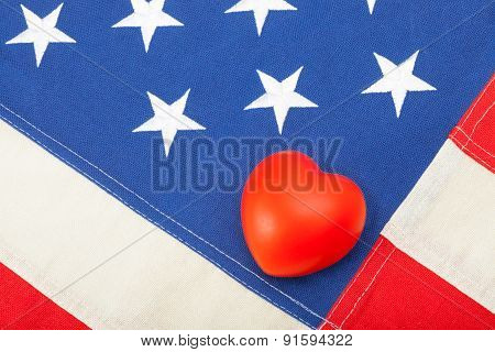 Neat Usa Flag With Toy Heart Over It - Studio Shot