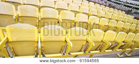 Yellow Seats In The Stands Before The Sporting Event