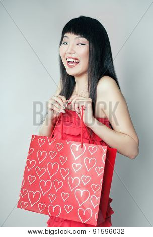 Shopping girl of Asian, closeup portrait with clipping path.