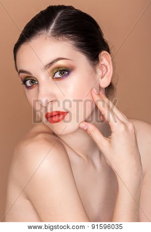 Beauty fashion girl. Portrait of beautiful young woman with fresh clean skin on baige background