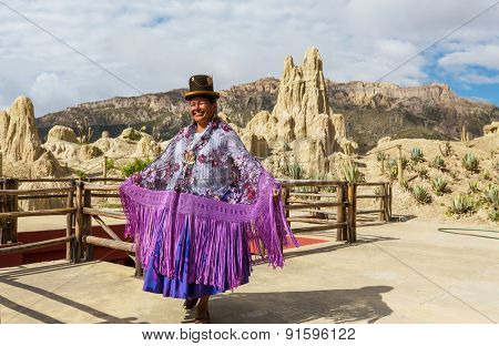LA PAZ, BOLIVIA - MARCH 31, 2013: An unidentified woman in traditional colourful clothes in Valle de la Luna - touristic attraction in La Paz, Bolivia.