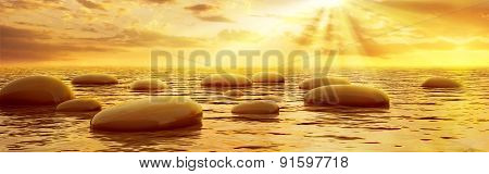 Smooth Stones Reflecting In Water At Sunset
