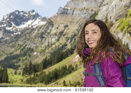 Woman Hiker In Front Of Mountains