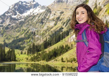 Woman Hiking On Swiss Mountains