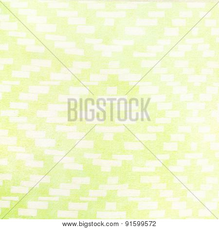 handmade ornament weaves on green paper background - abstract graphic design