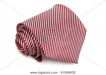 folded red tie on a white background