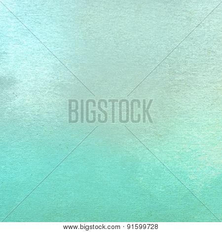 Turquoise watercolor painted on textured paper - Abstract Background close up