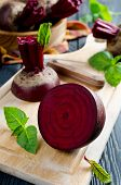 stock photo of basil leaves  - Beets and Basil leaves on wooden table - JPG
