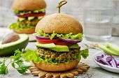 stock photo of millet  - spicy vegan curry burgers with millet chickpeas and herbs - JPG
