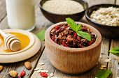 picture of quinoa  - oatmeal nuts quinoa granola on a dark wood background - JPG