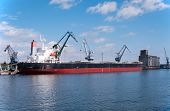 image of loading dock  - Port cranes loading the ship in the harbor in Gdansk Poland - JPG
