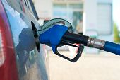 pic of gasoline station  - The car is fueled with gasoline at a gas station - JPG