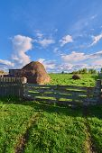 foto of haystack  - Haystack on the green grass in the spring - JPG