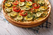 foto of zucchini  - rustic vegetable quiche with cheese tomatoes and zucchini closeup - JPG