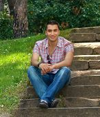 picture of stairway  - Beautiful young men sitting on stairway outdoor  - JPG
