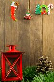 foto of pine cone  - xmas decoration with red candlestick and brown pine cone on wooden background - JPG