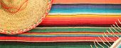Постер, плакат: Traditional Mexican Fiesta Poncho Rug In Bright Colors With Sombrero