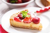 image of tarts  - Strawberry tart with custard on the table - JPG