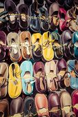 picture of flea  - Leather shoes in different colors at a flea market - JPG