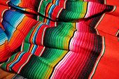 picture of mexican fiesta  - sequin and decorative ornate mexican hat ready for a fiesta with a gun - JPG