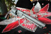 foto of mexican fiesta  - sequin and decorative ornate mexican hat ready for a fiesta with a gun  - JPG