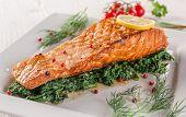 foto of salmon steak  - Salmon steak with spinach on white plate - JPG