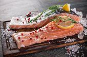 image of salmon steak  - Delicious salmon steak on wooden table - JPG