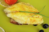 stock photo of plate fish food  - roast sea sole fish fillet served on bread with tomatoes - JPG