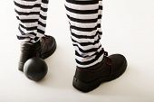 foto of ball chain  - Man prisoner legs with chain ball - JPG