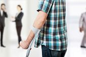 foto of crutch  - Young disabled man with crutches - JPG